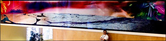 Angus in front of his wall mural - Yellowknife Public School